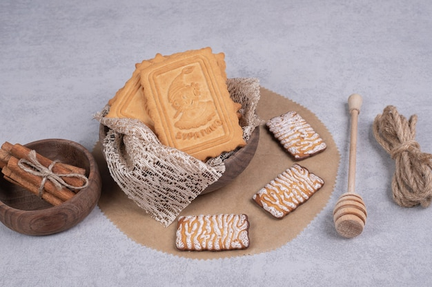 Bunch of various biscuits and cinnamon sticks on gray background. high quality photo