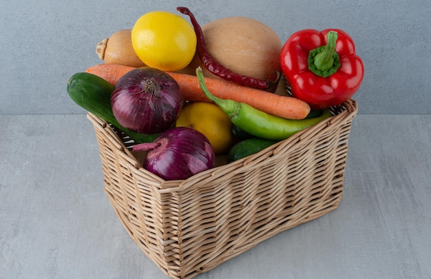 Bunch of various vegetables in wooden basket.