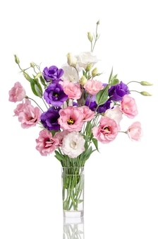 Bunch of violet, white and pink eustoma flowers in glass vase