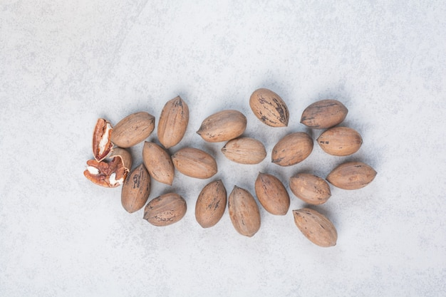 Bunch of walnut and kernels on blue surface