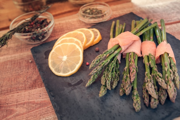 Bunches of asparagus wrapped in salmon with spices