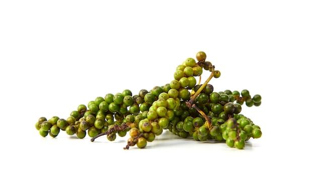 Bunches of fresh green peppercorns