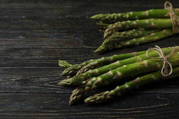 Bunches of green asparagus on wooden