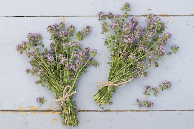 Bunches of thyme on table