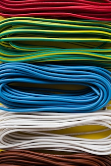 Bundle of colorful electric cable arranged in row