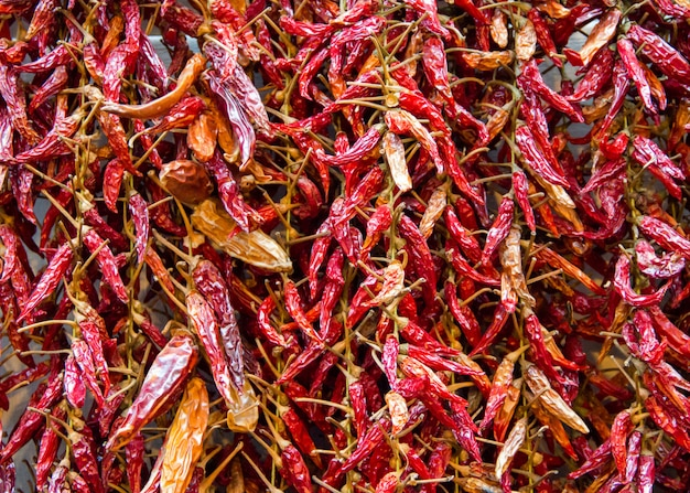 Bundle of dried red hot pepper on a market close up