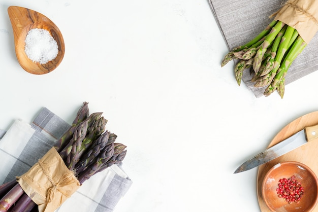 Bundles of fresh natural green and purple asparagus and different species