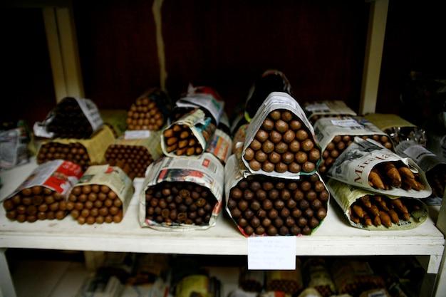 Bundles of handmade cigars at factory