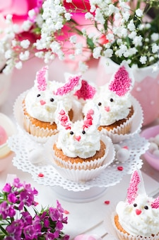 Bunny cupcakes on white cake stand. easter dessert