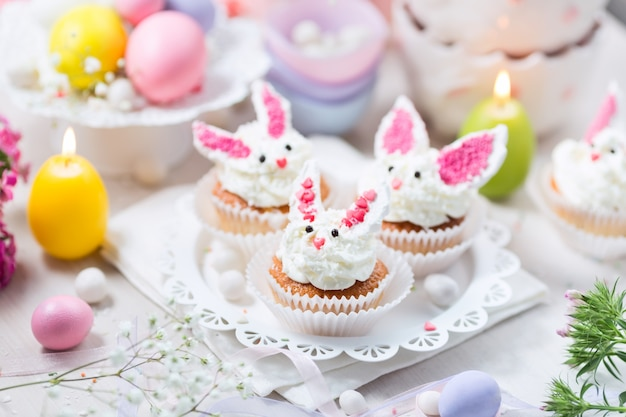 Bunny cupcakes on a white cake stand.