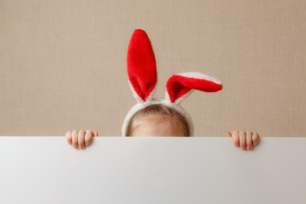 Bunny little girl with blank banner. place for text