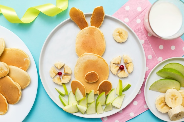 Bunny made of pancakes with bananas and apples