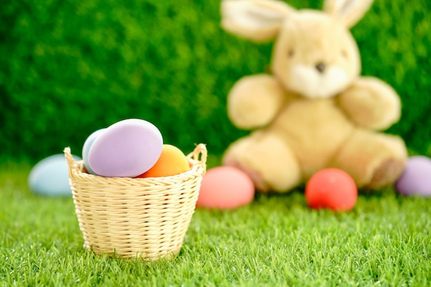 Bunny toy and easter eggs in basket