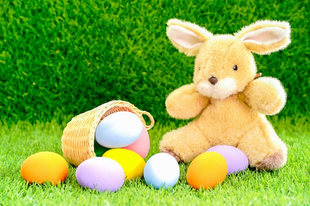 Bunny toy and easter eggs in a basket