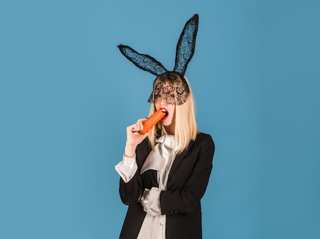 Bunny woman with carrot. easter rabbit girl with black ears.