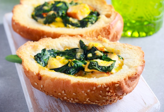 Buns with spinach, cheese, chicken and egg filling, baked