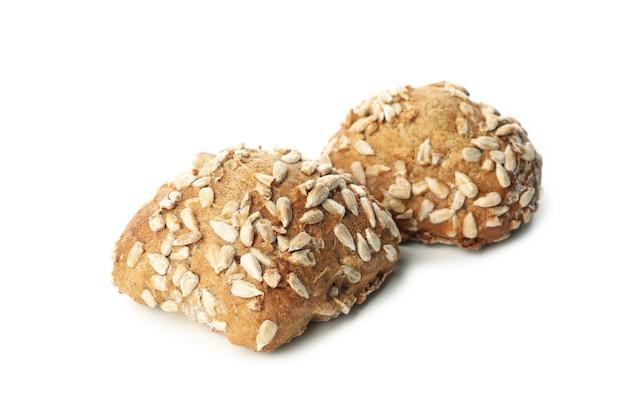 白で分離されたヒマワリの種のパン