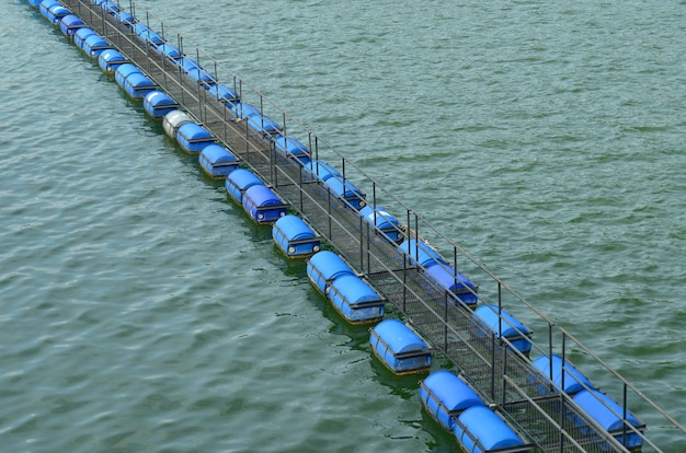 Buoy floating on water in hydroelectric power plant of dam