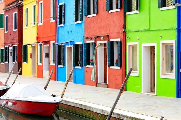 Burano island canal, small colored houses and the boats