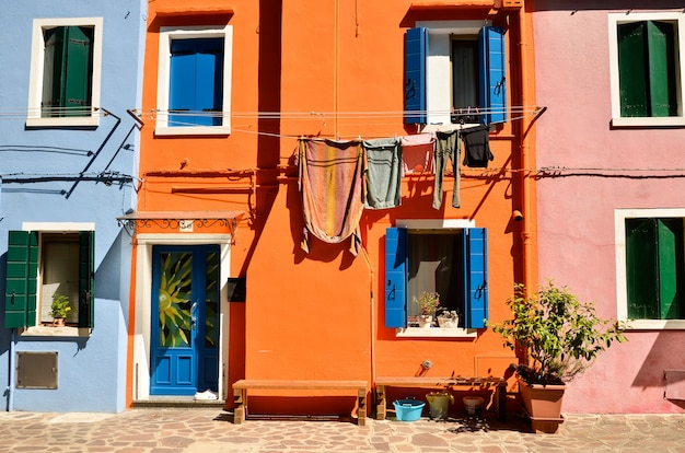 Burano island near venice, italy. colorful concept, orange and blue