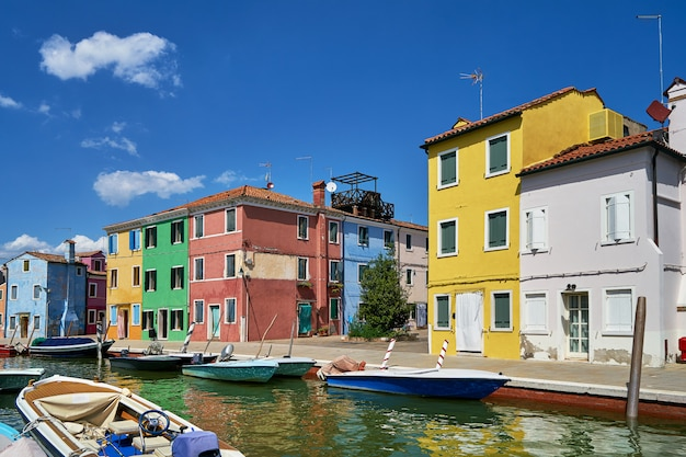 Burano, venice. colorful houses architecture, burano island canal and boats.