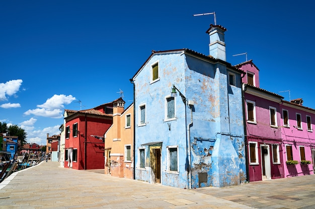 Burano, venice. old colorful houses architecture at the square.