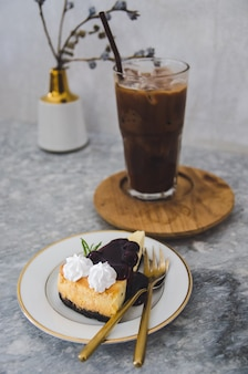 Burberry cheese cake and iced cocoa glass focus on cake