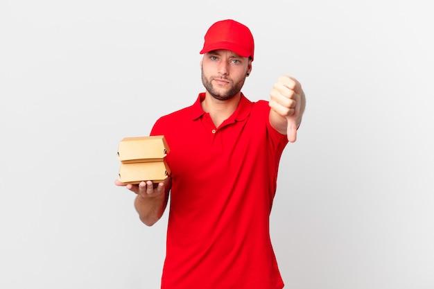 Бургер доставить человека, чувствуя крест, показывая пальцы вниз