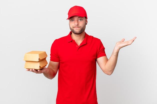 Бургер доставить человека, чувствуя недоумение, смущение и сомнения