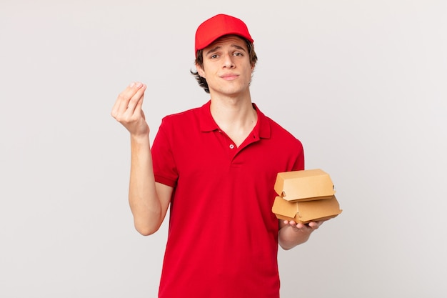 Burger deliver man making capice or money gesture, telling you to pay