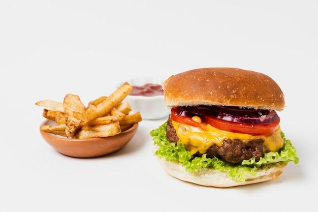 Burger and fries on white table