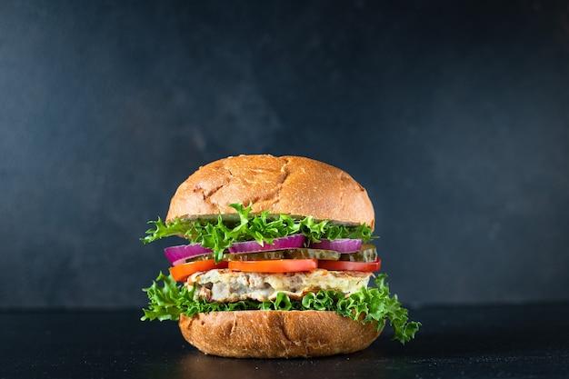 Burger meat pork, beef or chicken grilled cutlet sandwich and vegetables
