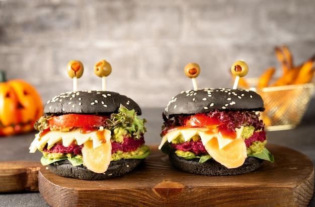 Burger monster for halloween celebration on dark