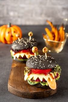 Burger monster for halloween celebration on dark