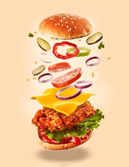 Burger with flying ingredients.
