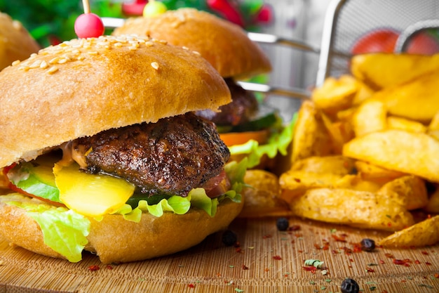 Burger with french fries in food board