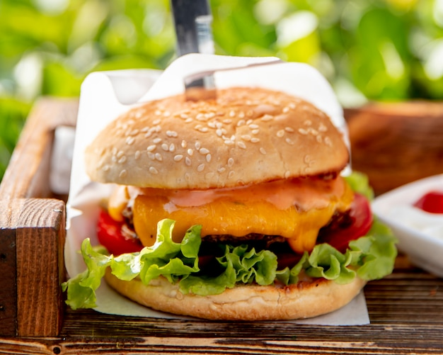 Burger with lettuce tomatoes and cheese
