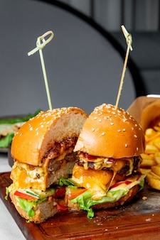 Burger with meat cutlet tomatoes lettuce and cheese