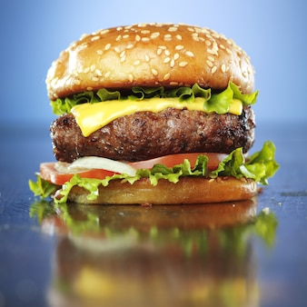 Burger with melted cheese and sesame bun