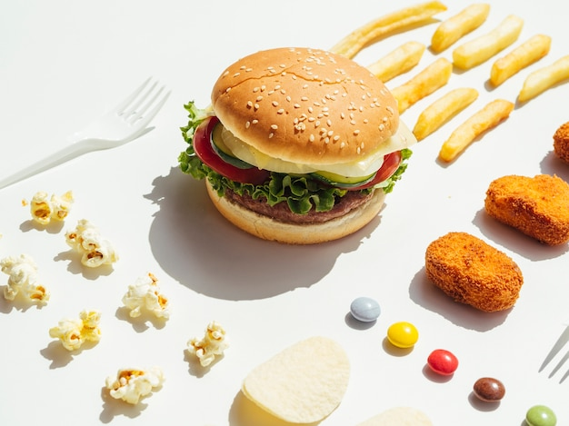 Burger with nuggets, candy and popcorn