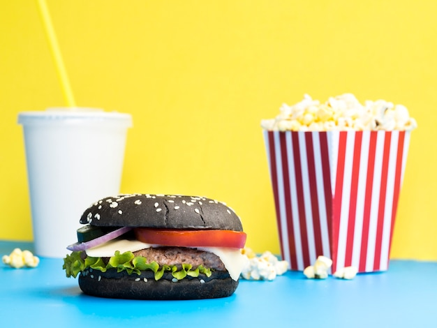 Burger with popcorn and soda
