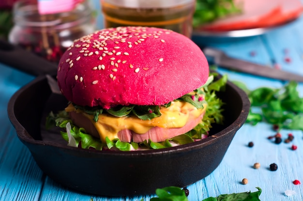 Burger with sausage and spices