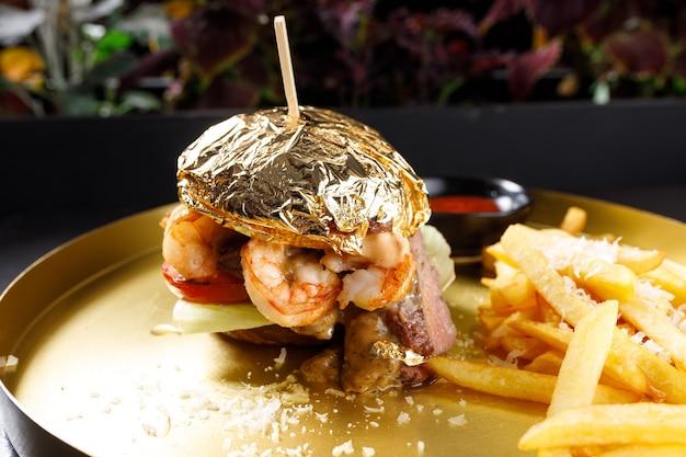 Burger with shrimp potatoes and sauce