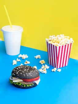 Burger with soda and popcorn