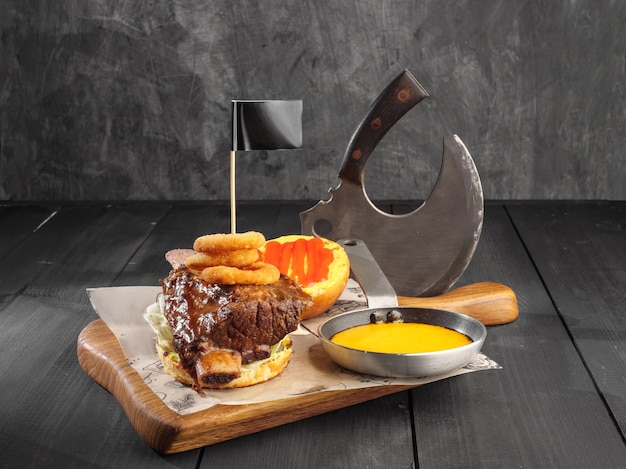 Burger with stewed beef rib on a dark background