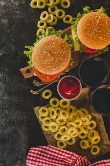 Burgers, drinks and onion rings