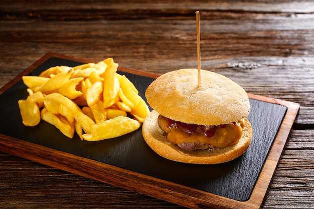 Burguer and french fries potato chips