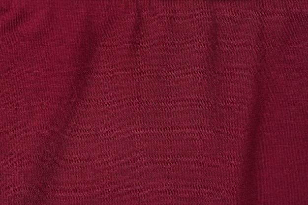 Burgundy knit fabric.