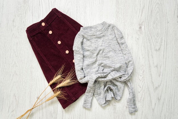 Burgundy suede skirt and gray sweater,