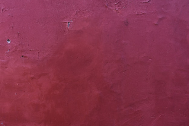 Burgundy wine background of old plaster on the wall